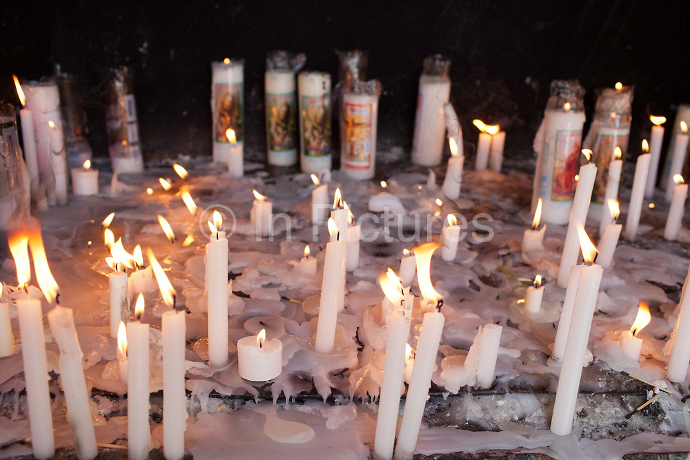 Candles for the dead. Often the lines between Candomble and Catholicism are blurred. This is especially true with the Sao Lazaro event in late January in Salvador, Bahia, Brazil, the city which is known as the home of Candomble. Sao Lazaro represents healing and the sick.