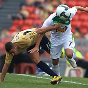 Tarek Elrich (left) and Chris Tadrosse in action during the Newcastle Jets V North Queensland Fury  A-League match at Energy Australia Stadium, Newcastle, Australia, 20 December 2009. Photo Tim Clayton