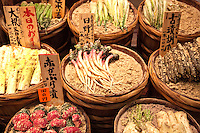 """Tsukemono Pickles at Nishiki Market  - a narrow shopping street made up of more than one hundred vendors.  Various kinds of fresh foods including many Kyoto specialties such as pickles and Japanese sweets, as well as fresh seafood and vegetables are sold.  Known as """"Kyoto's Kitchen"""" Nishiki Market's history goes back several centuries and many stores have been operated by the same families for generations."""