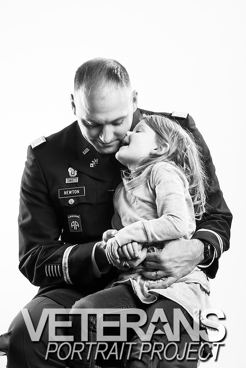 """U.S. Army First Lieutenant Martin K. Newton began his career as an enlisted combat photographer in 1994, after which time he deployed to Afghanistan and Iraq. After two deployments, he married in 2009 and his daughter, Bella, was born later that year. In light of making the military a lifelong career, Newton finished his degree in 2010, was commission as an officer and deployed once again to Afghanistan. """"Serving my country means I'm part of a very small number of people who've chosen to serve their country no matter what the circumstance,"""" explains Newton. <br /> <br /> Veterans Portrait Project<br /> Austin, TX"""