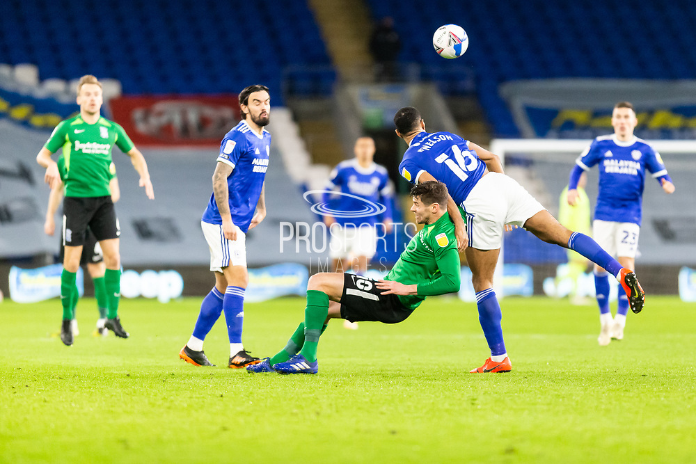 Cardiff City's Curtis Nelson (16) wins the ball from Birmingham City's Lukas Jutkiewicz (10) during the EFL Sky Bet Championship match between Cardiff City and Birmingham City at the Cardiff City Stadium, Cardiff, Wales on 16 December 2020.