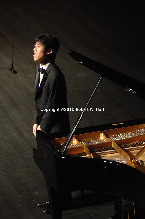 20-year-old Cliburn gold medalist, Haochen Zhang, takes a bow during his performance Tuesday September 14, evening at the Bass Hall in Fort Worth, Texas. This was Zhang's first performance since his gold medal win at the 2009 Cliburn Competition.