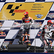 28 August 2011: Moto GP Repsol Honda Team rider Casey Stoner (27) celebrates his victory with his teammate Moto GP Repsol Honda Team rider Dani Pedrosa (26) and Moto GP Yamaha Factory Racing rider Ben Spies (11) following the Red Bull Indianapolis Gran Prix MOTO GP at the Indianapolis Motor Speedway in Indianapolis, IN..