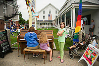Stopping to play a tune on a summer day on Main Street Wolfboro, NH.  ©2016 Karen Bobotas Photographer