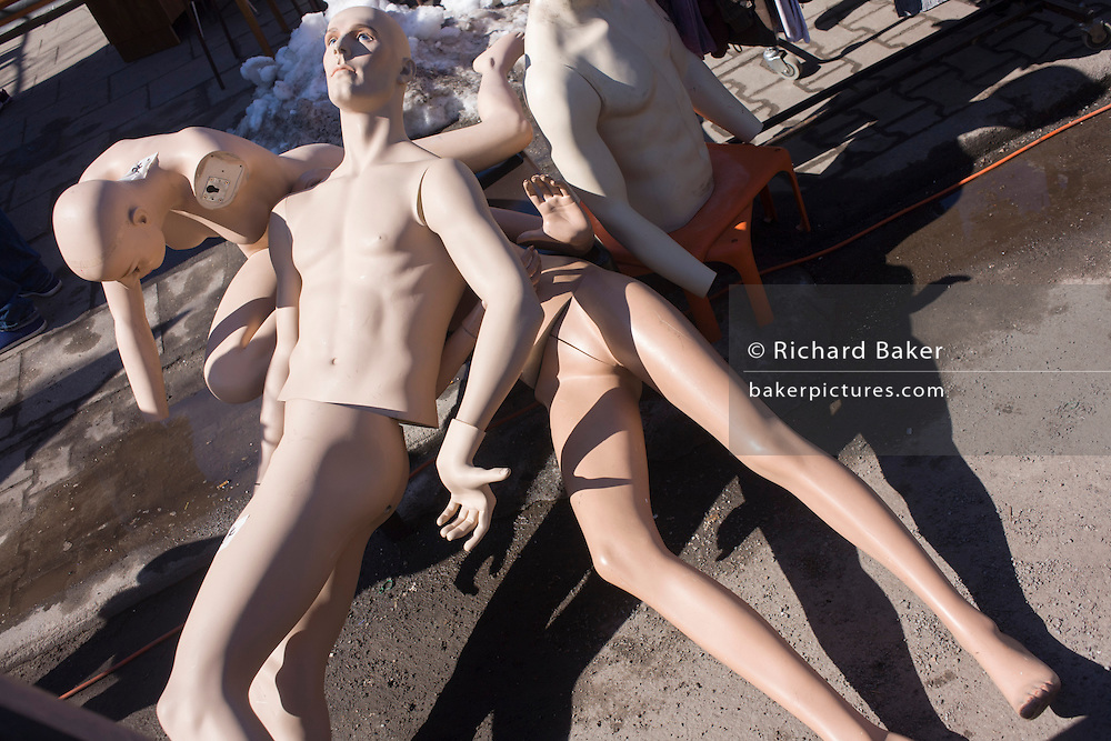 A pile of mannequins awaiting a buyer at a giant market in Mauerpark - an open space on the site of the old Berlin wall, the former border between Communist East and West Berlin during the Cold War.