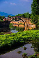 A beautiful arched bridge on the outskirts of the market town of Shaxi, on the Tea Horse Caravan Road, which links Southern Yunnan to Tibet and Burma and retains its position as one of the best preserved historic market hubs today. Yunnan Province, China.