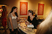 Ines de Bordas and Jana Pasquel, Treasures From The Gem Palace, Private view of gem stones created by a family of Indian court jewellers from Jaipur (the Kasliwals). Somerset House, London, WC2, 28 September 2006. www.somerset-house.org.uk-DO NOT ARCHIVE-© Copyright Photograph by Dafydd Jones 66 Stockwell Park Rd. London SW9 0DA Tel 020 7733 0108 www.dafjones.com