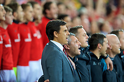 CARDIFF, WALES - Monday, October 9, 2017: Wales' manager Chris Coleman sings the national anthem before the 2018 FIFA World Cup Qualifying Group D match between Wales and Republic of Ireland at the Cardiff City Stadium. (Pic by Paul Greenwood/Propaganda)
