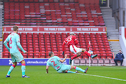 Ryan Bennett of Swansea City prevents Lyle Taylor of Nottingham Forest shooting from the edge of the 6 yard box - Mandatory by-line: Nick Browning/JMP - 29/11/2020 - FOOTBALL - The City Ground - Nottingham, England - Nottingham Forest v Swansea City - Sky Bet Championship