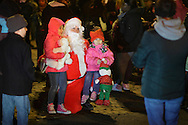 Newburgh, New York  - Children pose for a picture with Santa Claus after the Christmas tree lighting ceremony on Broadway on the night of Dec. 14, 2011.