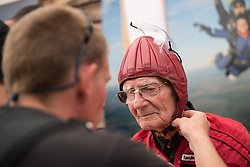 © Licensed to London News Pictures. 25/08/2016. <br /> <br /> Pictured: D-Day Veteran Fred Glover prepares for his parachute jump.<br /> <br /> Fred Glover and Ted Pieri, two D-Day veterans who are both 90 years old have parachuted into Sarum Airfield, Wiltshire on Thursday 25th August 2016, 72 years after D-Day having earlier in the month parachuted into Merville Battery in France.<br /> <br /> <br /> Photo credit should read Max Bryan/LNP
