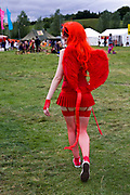 A woman dressed as a devil walks through the  Standon Calling Festival in Hertfordshire, UK.<br /> Standon Calling is a small independent festival set among the hills in Herfordshire that showcases World Music, Indie Music and dance Music. It is one of the new, small and quirky boutique festivals which have become popular in the UK.