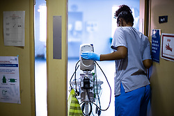 © Licensed to London News Pictures . 12/02/2021 .  Manchester , UK . A clinician enters a patient bay on Ward 4 , the Respiratory Cohort Area . Inside Manchester Royal Infirmary , where patients are being treated for the effects of Coronavirus . Photo credit : Joel Goodman/LNP
