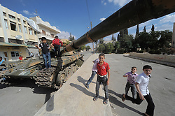 © Licensed to London News Pictures. Azaz, Syria. 05/10/2012. Children play amongst ruins caused by the recent shelling in Azaz, Northern Syria. Photo credit: Andrew chittock/LNP