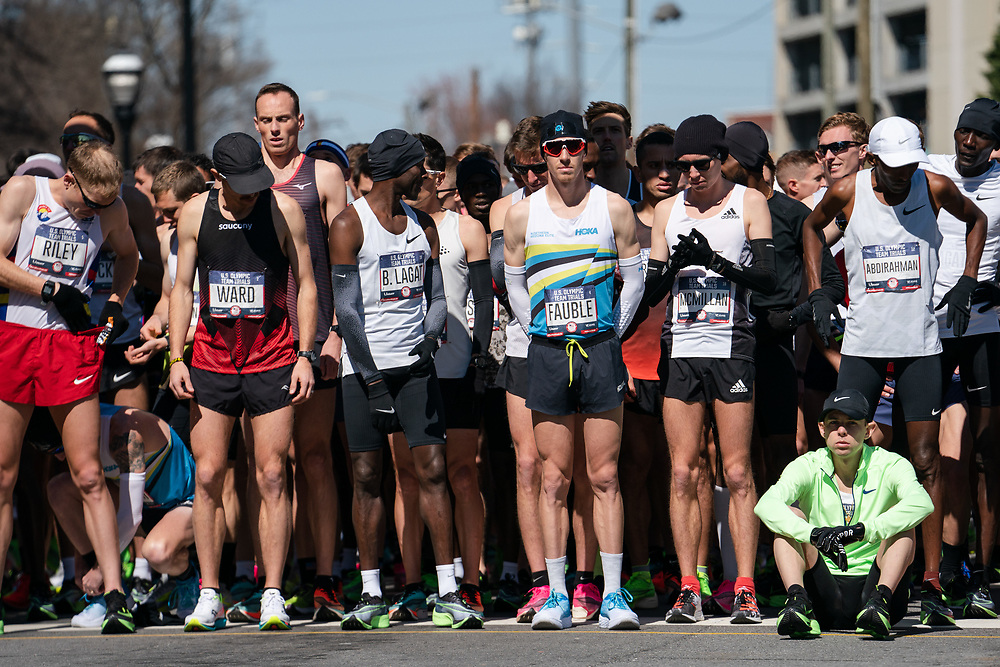Galen Rupp (seated) and other runners prepare to start the 2020 U.S. Olympic marathon trials in Atlanta on Saturday, Feb. 20, 2020. Photo by Kevin D. Liles for The New York Times