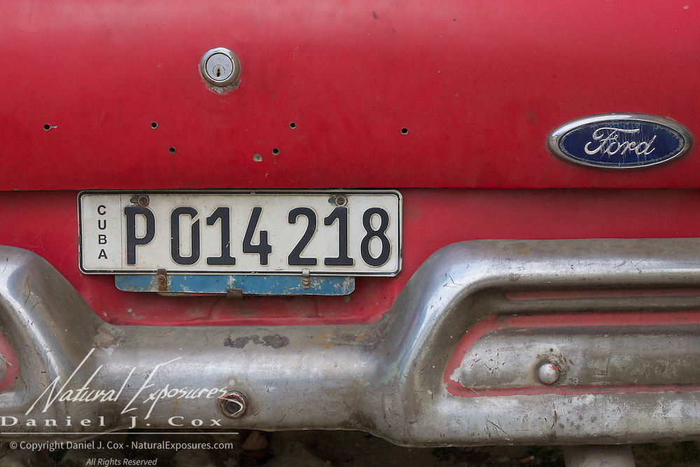 Details of a vintage Ford automobile on the streets of Trinidad, Cuba.