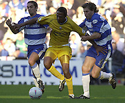 Reading, England, Nationwide Division One Football Reading v Preston North End, Preston's Ricardo Fuller, sandwiched between Reading's Scott Murray [left] and John Mackie. at the Madejski Stadium, on  18/10/2003  [Credit  Peter Spurrier/Intersport Images]..