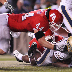 Oct 16, 2009; Piscataway, NJ, USA; Rutgers linebacker Ryan D'Imperio (44) tackles Pittsburgh running back Dion Lewis (28) during second half NCAA football action in Pittsburgh's 24-17 victory over Rutgers at Rutgers Stadium.