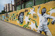 A mural close to the legendary Maracana stadium in Rio de Janeiro depicts some of Brazil's most illustrious footballing legends, such as Taffarell, the '94 Worl Cip golkeeper as well as other stars from the past campaigns, such as Pele and Zico