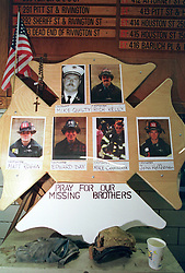 14 September 2001. New York, New York - USA.<br /> Post 9/11 World Trade Center attack.<br /> Makeshift tribute to firemen Edward Day, Matt Rogan, Mike Quilty, Rich Kelly, Mike Cammarata, John Heffernan. Missing presumed dead. Hero firefighter, colleagues of Mike Kehoe of Engine 28, Ladder 11 pictured in a memorial erected at their firehouse on East 2nd Street in the East village early in the morning of Sept 14th. <br /> Mike Kehoe's image had been published the day before on front pages around the world. It is the iconic image of him ascending the stairs of the World Trade Center as he helped to evacuate people from the terrorist attacks of 9/11. It was assumed Mike had perished when the buildings collapsed. However Mike had miraculously managed to escape the buildings moments before they collapsed. 6 members of his crew were not so fortunate. Mike became a symbol of heroism to many following the vicious Al Queda attacks which claimed over 2,000 victims at the WTC site. This images was published exclusively on the Front Page of the Daily Mirror on 15th Sept, 2001.<br /> Photo exclusive©; Charlie Varley/varleypix.com