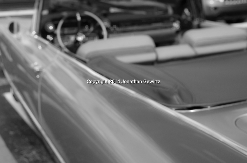 A blurry, dreamy black and white view of a 1960 Cadillac convertible. WATERMARKS WILL NOT APPEAR ON PRINTS OR LICENSED IMAGES.