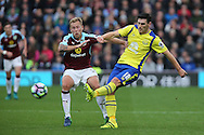 Gareth Barry of Everton crosses under pressure from Scott Arfield of Burnley. Premier League match, Burnley v Everton at Turf Moor in Burnley , Lancs on Saturday 22nd October 2016.<br /> pic by Chris Stading, Andrew Orchard sports photography.