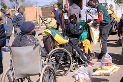 South Africa - Fort Beaufort - 13 - August - 2020 -Ali Sablay of gift of the givers donated food to Elizabeth Redcliff from Newtown.Newtown township has been hit hard by corona. Gift of the givers distrubuted food  parcels to the most vulnerable in the area. Photographer Ayanda Ndamane African News Agency(ANA)