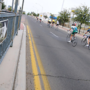 Bicycle racers pass by tagged 6th Avenue one-way traffic during 2012 El Tour de Tucson. Bike-tography by Martha Retallick.