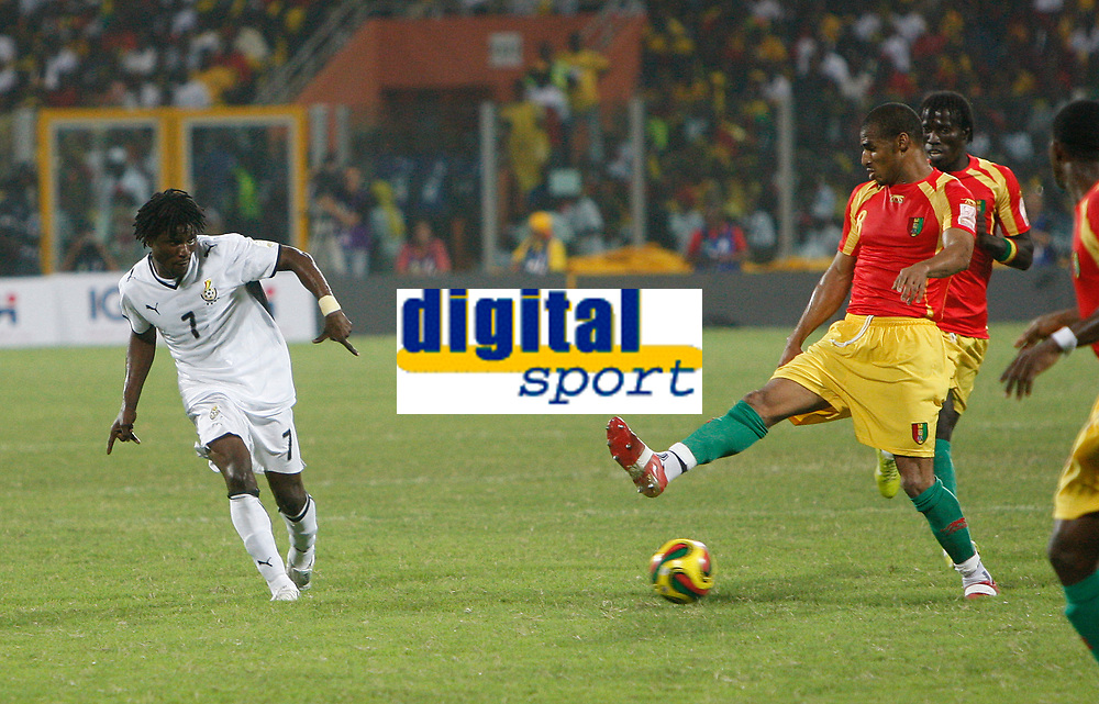 Photo: Steve Bond/Richard Lane Photography.<br />Ghana v Guinea. Africa Cup of Nations. 20/01/2008. Laryea Kingston (L) tries to thread the ball through as Kanfory Sylla (R) stretches to block