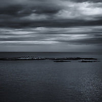 """""""Rain on My Parade""""<br /> <br /> A black and white photograph of dark rain clouds over Lake Superior"""