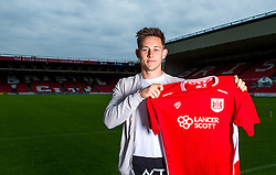 New Bristol City signing Josh Brownhill poses for a picture with a Bristol City shirt - Mandatory by-line: Robbie Stephenson/JMP - 31/05/2016 - FOOTBALL - Ashton Gate - Bristol, England - Bristol City New Signing - Josh Brownhill