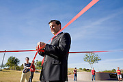 01 DECEMBER 2008 -- PHOENIX, AZ: PHIL GORDON, the mayor of Phoenix, AZ, holds up the center of the AIDS ribbon Phoenix AIDS activists created Monday. AIDS activists in Phoenix made the world's largest AIDS Ribbon to mark World AIDS Day, Dec. 1. According to Guinness  World Records, the previous largest AIDS ribbon measured 43 feet long. The ribbon created the Phoenix activists was more than 330 feet long. They plan to submit their ribbon to the Guinness Book of World Records.   Photo by Jack Kurtz / ZUMA Press