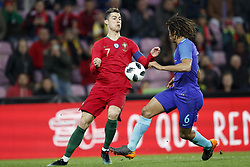 (L-R) Cristiano Ronaldo of Portugal, Nathan Ake of Holland during the International friendly match match between Portugal and The Netherlands at Stade de Genève on March 26, 2018 in Geneva, Switzerland