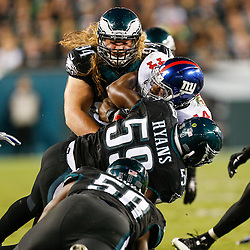 Philadelphia Eagles defensive tackle Beau Allen #94 and inside linebacker DeMeco Ryans #59 tackle the ball carrier during the NFL game between the New York Giants and the Philadelphia Eagles at Lincoln Financial Field in Philadelphia on Sunday October 12th 2014. The Eagles won 27-0. (Brian Garfinkel/Philadelphia Eagles)