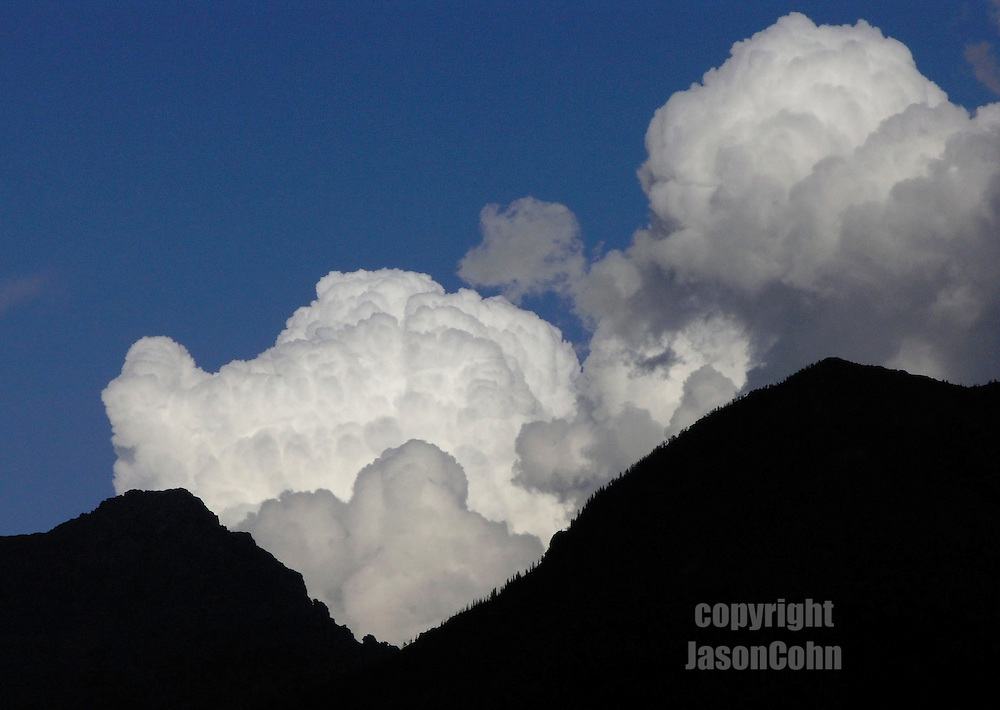Afternoon clouds over mountains in Glacier Park, Montana. Photo by Jason Cohn