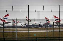 © Licensed to London News Pictures. 11/12/2017. London, UK. British Airways aircraft are seen at Heathrow. British Airways had cancelled 30 flights before 10am today leaving hundreds stranded.  Photo credit: Peter Macdiarmid/LNP