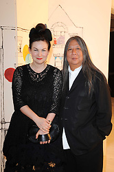 Designer JOHN ROCHA and his wife ODETTE at a dinner hosted by Harper's Bazaar to celebrate Browns 40th Anniversary in aid of Women International held at The Regent Penthouses & Lofts, 16-18 Marshall Street, London on 20th May 2010.
