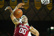 WACO, TX - JANUARY 24: Ryan Spangler #00 of the Oklahoma Sooners drives to the basket against the Baylor Bears on January 24, 2015 at the Ferrell Center in Waco, Texas.  (Photo by Cooper Neill/Getty Images) *** Local Caption *** Ryan Spangler