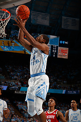 CHAPEL HILL, NC - FEBRUARY 05: Kenny Williams #24 of the North Carolina Tar Heels goes to the basket during a game against the North Carolina State Wolfpack on February 05, 2019 at the Dean Smith Center in Chapel Hill, North Carolina. North Carolina won 113-96. North Carolina wore retro uniforms to honor the 50th anniversary of the 1967-69 team. (Photo by Peyton Williams/UNC/Getty Images) *** Local Caption *** Kenny Williams
