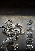 A detail on an incense burner in Jietaisi. On a wooded hill west of Beijing is Jietai Temple, one of China's most famous ancient Buddhist sites. Its four main halls occupy terraces on a gentle slope up to Ma'an Shan (Saddle Hill). Originally built in AD 581, the temple complex expanded over the centuries and grew to its current scale in a major renovation conducted by Ming-era devotees from 1436 to 1450.