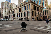 An abandoned desk chair at Michigan Avenue and Randolph Street during the 5 p.m. evening rush hour Tuesday, March 17, 2020 in Chicago's Loop. (Brian Cassella/Chicago Tribune)
