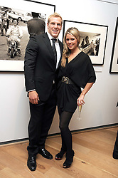 Rugby player JAMES HASKELL and FELICIA FIELD at the TAG Heuer British Formula 1 Party at the Mall Galleries, London on 15th September 2008.