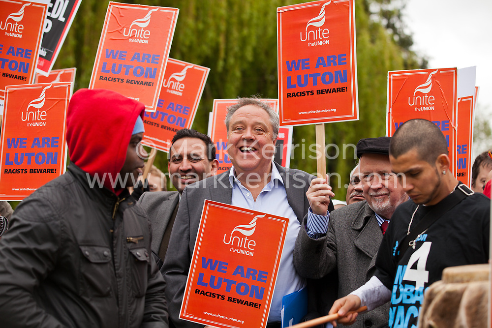 Luton, UK. 5th May, 2012. Richard Howitt (c), MEP for East of England, and Kelvin Hopkins (r), Labour MP for Luton North, attend the We Are Luton/Stop The EDL rally, organised by We Are Luton and Unite Against Fascism in protest against a march by the far-right English Defence League.