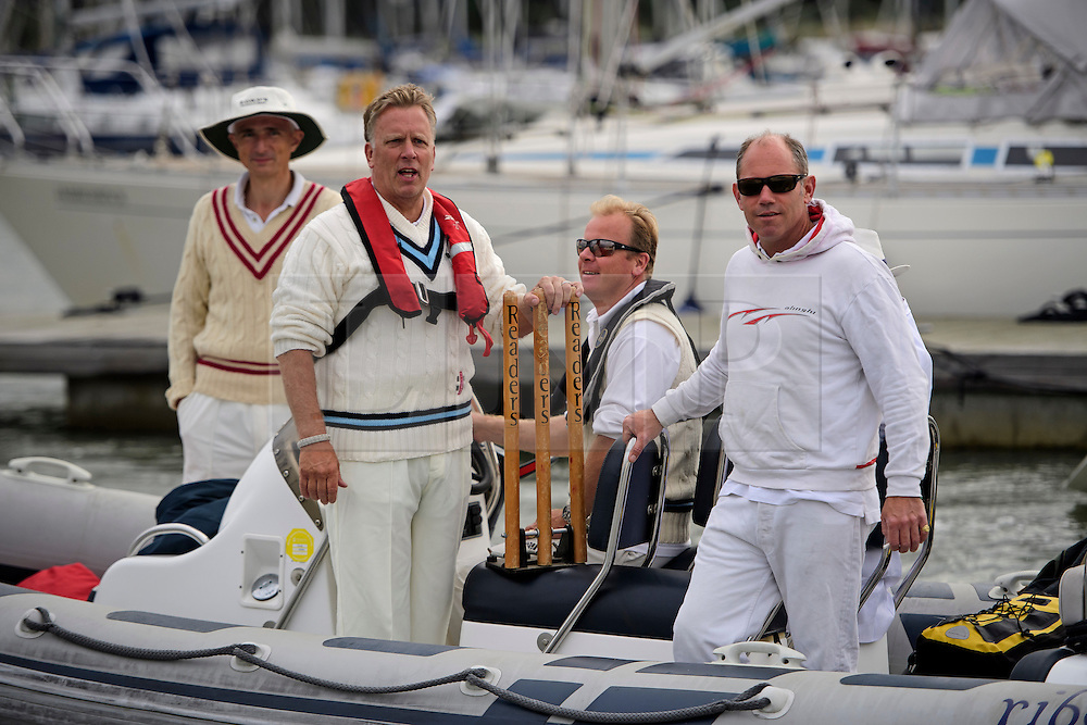 © Licensed to London News Pictures. 18/09/2016. Portsmouth, UK. The teams make their way to the bank with the wickets. Teams take part in the  Bramble Bank Cricket Match in the middle of The Solent strait on September 18, 2016. The annual cricket match between the Royal Southern Yacht Club and The Island Sailing Club, takes place on a sandbank which appears for 30 minutes at lowest tide. The game lasts until the tide returns. Photo credit: Ben Cawthra/LNP