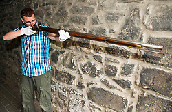 Pictured: Curator Nico Tyack takes aim with an 18th century musket<br /> <br /> The latest Museum of Edinburgh exhibition documents the history of Edinburgh's Town Guard, which brought law and order to the city in the 18th century. Curator Nico Tyack and Museum Assistant David Mclay examined muskets, halberds and drums before the exhibition was opened to the public<br /> <br /> Ger Harley   EEm 15 June 2017