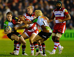 Harlequins Winger (#14) Tom Williams is tackled by Gloucester Inside Centre (#12) Billy Twelvetrees during the second half of the match - Photo mandatory by-line: Rogan Thomson/JMP - Tel: Mobile: 07966 386802 03/11/2012 - SPORT - RUGBY - Twickenham Stoop - London. Harlequins v Gloucester - Aviva Premiership