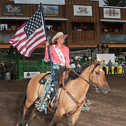 Sarai McCollaum carries the American flag during the opening of the Darby MT EPB.  Josh Homer photo.  Photo credit must be given on all uses.