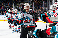 KELOWNA, BC - MARCH 6: Alex Swetlikoff #17 of the Kelowna Rockets celebrates a second period goal against the Seattle Thunderbirds with fist bumps downn the bench  at Prospera Place on March 6, 2020 in Kelowna, Canada. (Photo by Marissa Baecker/Shoot the Breeze)