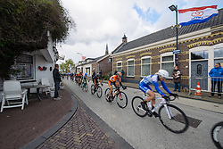 Peloton speed through 's-Heerenhoek with a strong tailwind in the finish straight at Omloop van Borsele 2016. A 139 km road race starting and finishing in 's-Heerenhoek, Netherlands on 23rd April 2016.