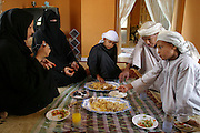A family in Dubai, United Arab Emirates, has a typical lunch of rice, chicken, olives, and salad on the floor of the dining room of their new house just outside the city in a subdivision of large homes. (Supporting image from the project Hungry Planet: What the World Eats.).